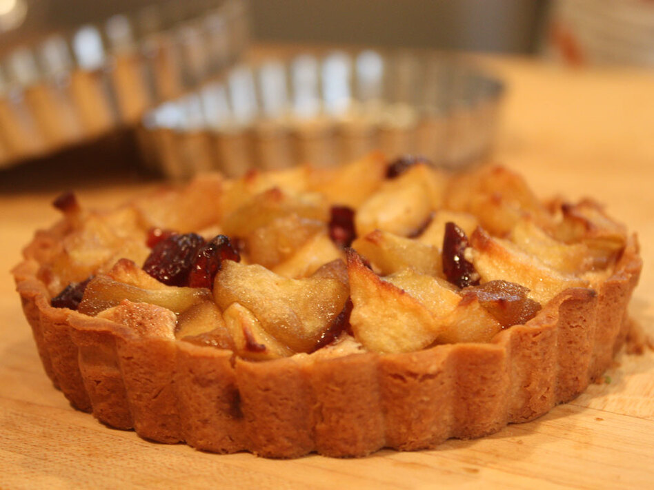 "Get the recipe for <a href=""http://www.npr.org/templates/story/story.php?storyId=131123226#131124092"">Apple Cranberry Frangipane Tart</a>."