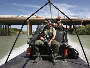 U.S. Border Patrol agents pass under the World Trade Bridge