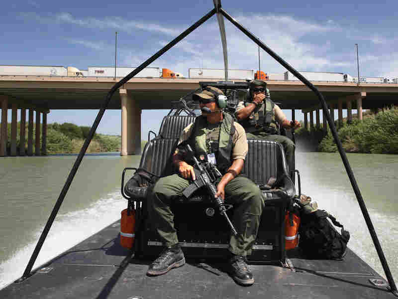 U.S. Border Patrol agents pass under the World Trade Bridge