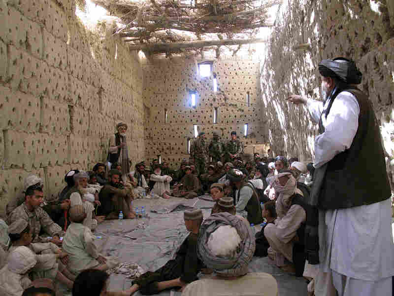 About three dozen Afghan elders and villagers meet with U.S. and Afghan troops in Panjwaii