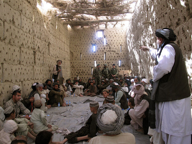 About three dozen Afghan elders and villagers attend a meeting with Afghan and U.S. troops at the  American compound in Panjwaii, about 15 west of the city of Kandahar.