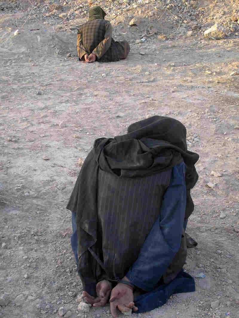 Afghan men are detained for questioning by U.S. soldiers.