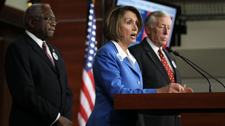 Current House Speaker Nancy Pelosi speaks as Majority Leader Steny Hoyer (right) and Majority Whip James Clyburn listen during a Sept. 30 news conference on Capitol Hill.