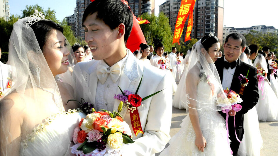 Chinese newlyweds pose during a collective wedding ceremony in Shanghai in November 2009. But just as fast as young Chinese couples are meeting and marrying, a mix of social and economic reasons are leading to equally quick divorces.