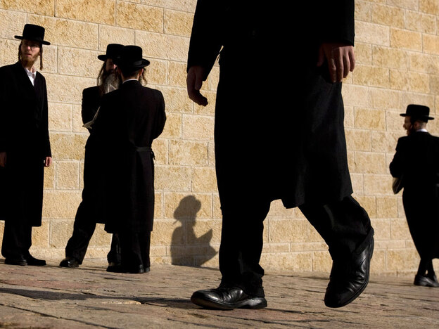 Ultra-Orthodox  Jewish men walk at Judaism's holiest site, the Western Wall in Jerusalem's Old City. Orthodox and ultra-Orthodox Jews are exerting growing power over religious matters in Israel.