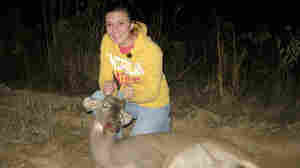 "Magan Hebert, 15, poses with the young buck, or ""spike"" that she shot in Wayneboro, Miss."