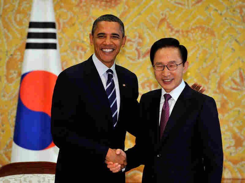 U.S. President Barack Obama shakes hands with South Korea's President Lee Myung-bak