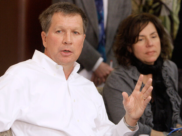Ohio Gov.-elect John Kasich (left) answers questions during a news conference. Kasich says he will reject $400 million in federal funds meant to establish high-speed passenger rail service from Cleveland to Columbus and Cincinnati.