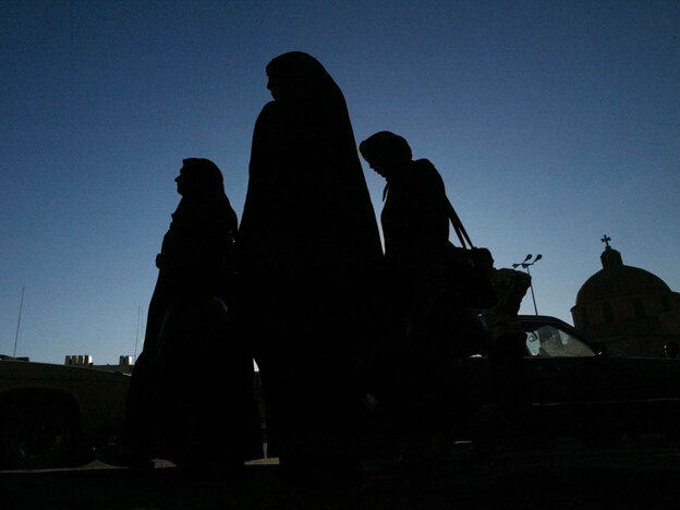 Iraqi women walk along a street in Baghdad. Human rights groups say girls and young women are often trafficked: with the promise of jobs, money or even love. One young Iraqi woman named Uhud was kidnapped, managed to escape and told her story to NPR.