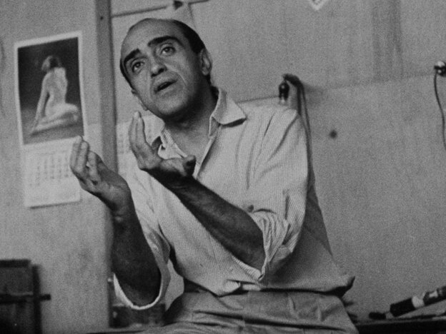 Architect Oscar Niemeyer, shown in 1960 in his office with a model of the Cathedral of Brasilia, created from scratch the monumental buildings of the Brazilian capital more than 50 years ago.