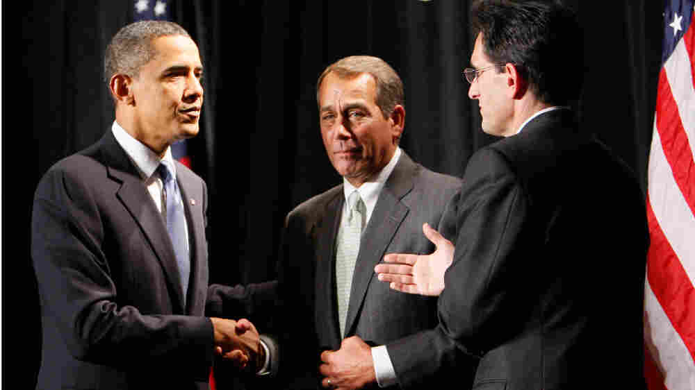 President Obama shakes hands with John Boehner as Eric Cantor looks on