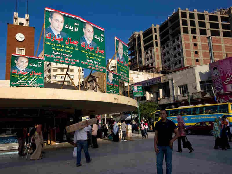 Posters supporting Gamal Mubarak, Hosni Mubarak's son, for next year's presidential race