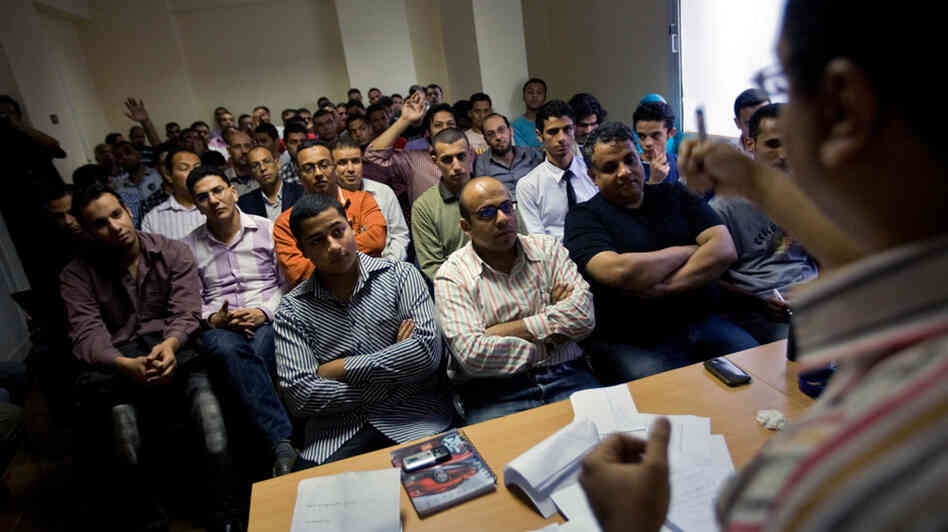 Volunteers packed into a room during a petition-drive training session in Cairo.