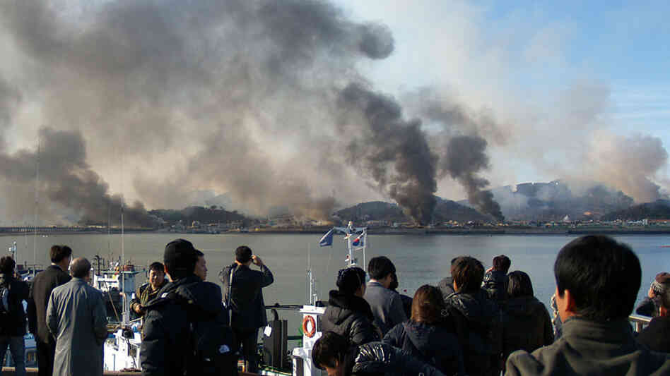 A picture taken by a South Korean tourist shows plumes of smoke rising from Yeonpyeong island.