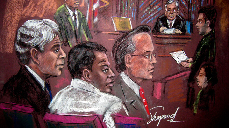 A courtroom drawing depicts Tanzanian Ahmed Ghailani (center) with his defense  attorneys in a New York court, Nov. 17. Ghailani was charged with more than 280 counts of murder and conspiracy for his role in the 1998 embassy bombings in Africa but was convicted of only a single charge. His case has highlighted the Obama administration's problematic stance on indefinite detention of terrorism suspects.