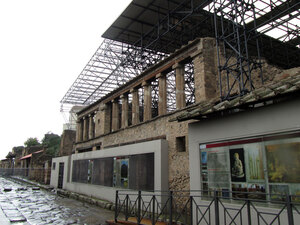 Steel scaffolding and the roof weigh on the original 2,000-year-old walls in Pompeii, Italy.