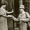 A mail carrier delivers a letter to a customer in Milwaukee, Wis., circa 1908.