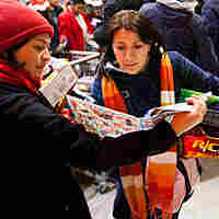 Shoppers look for bargains at Toys R Us in New York City.
