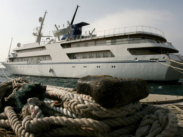 Saddam Hussein's luxury yacht, shown here in Greece in 2009, has gold-plated bathroom fixtures, a helipad and its own minisubmarine.