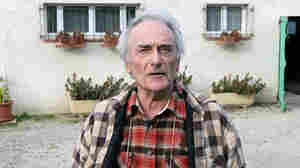 Seventy-one-year-old retired electrician Pierre Le Guennec talks to journalists in front of his home.