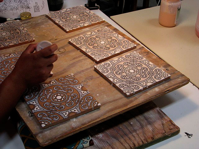 "Handpainting of Cuerda Seca Decorative Tiles on ""Debris Series"" recycled tile, San Jose, Calif."