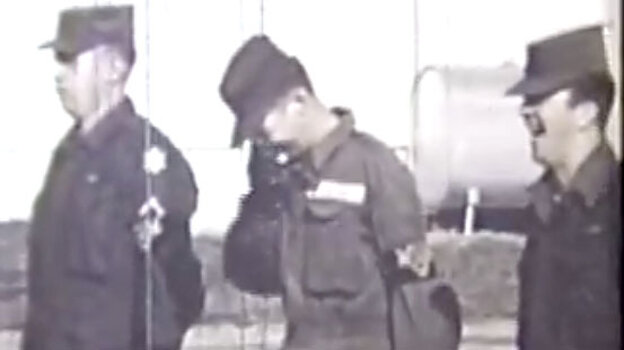 Screen grab of archival footage showing military LSD testing