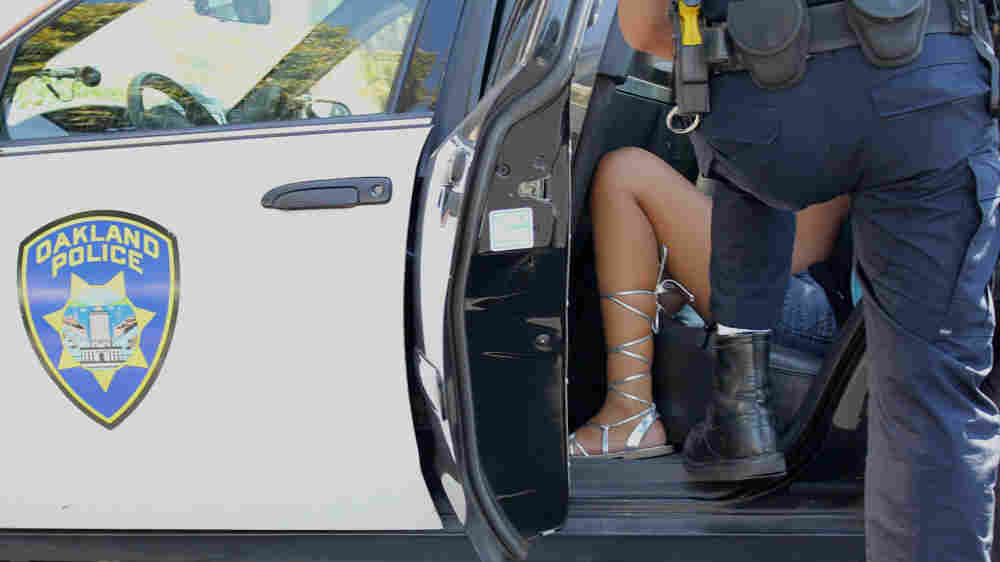 A girl in a police car