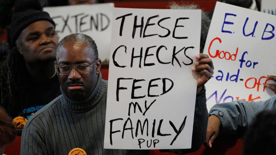 Frank Wallace, who is unemployed, displays a sign during a vigil in Philadelphia. The Philadelphia Unemployment Project and other organizations gathered to draw attention to federal unemployment benefits that are scheduled to expire. (AP)