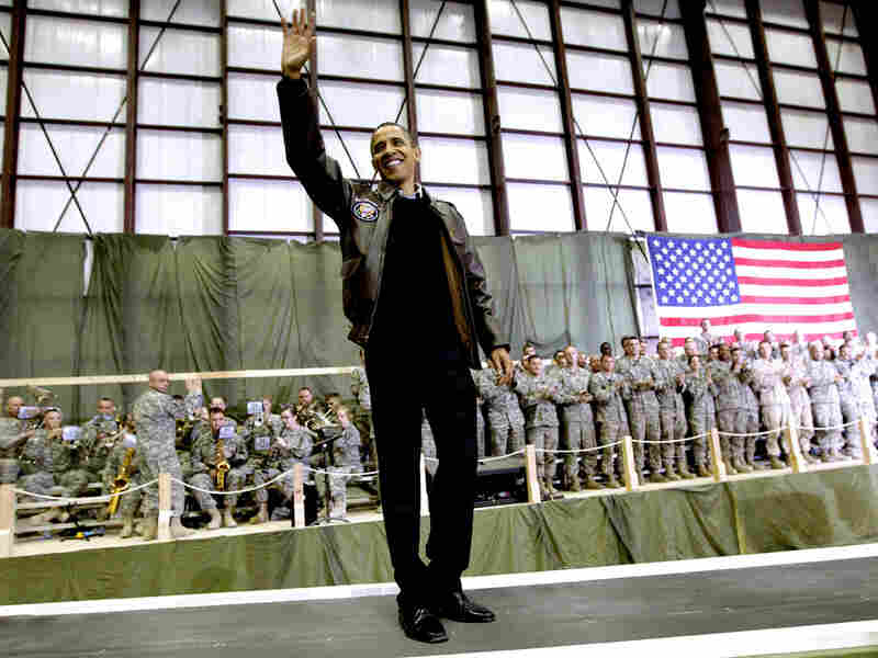 President Obama waves as he is introduced to the troops at Bagram Air Field in Afghanistan.