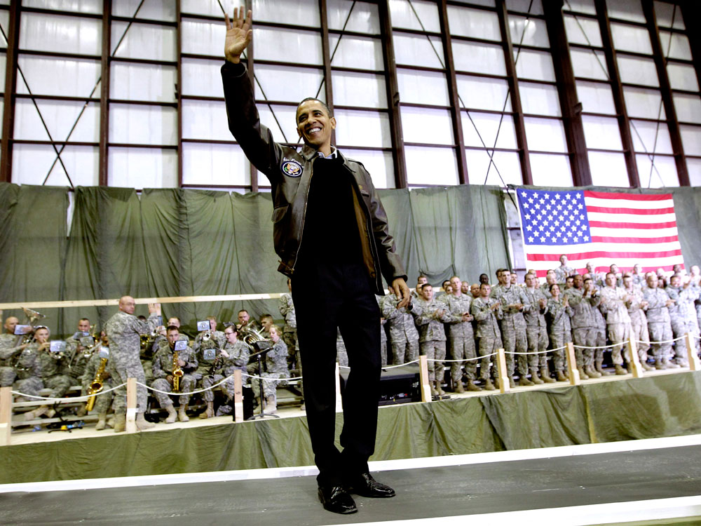Pablo Martinez Monsivais/AP  President Barack Obama waves as he is introduced to the troops at Bagram Air Field.
