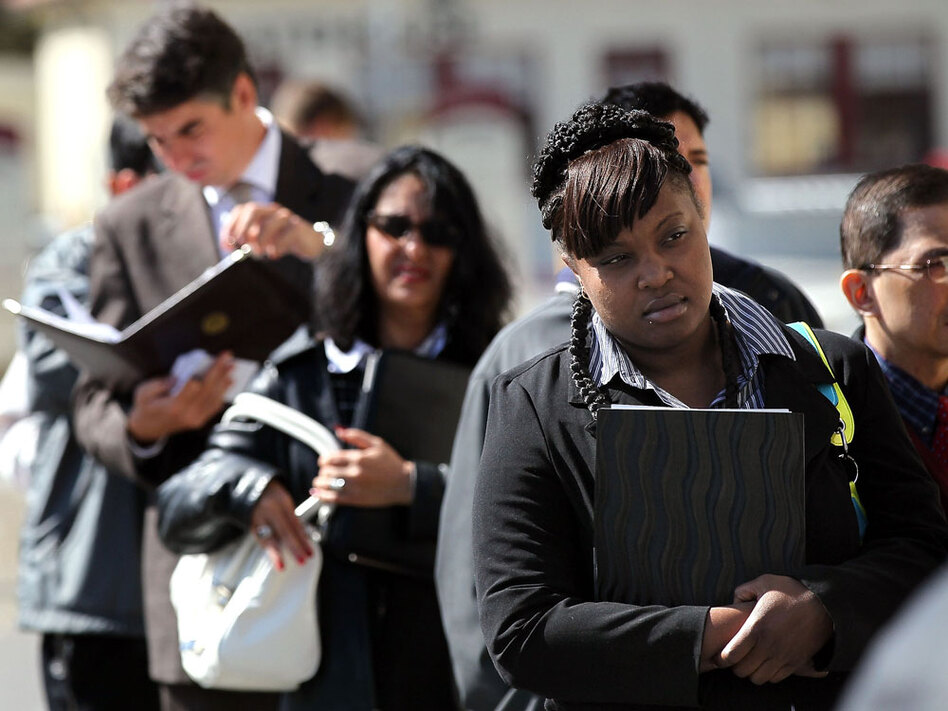 Job seekers wait in line before entering a job fair in San Francisco. Private employers added 50,000 jobs in November, down significantly from the 160,000 the previous month.