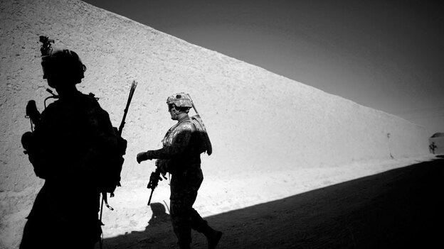 Soldiers from  the Army's 101st Airborne Division walk along high mud walls in a village in Afghanistan's Kandahar province. The Obama administration later this month will release its annual review of the war strategy. Afghanistan's history does not offer encouragement.