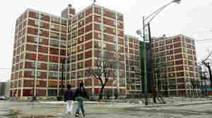 Two residents walk past Chicago's Cabrini-Green public housing buildings.