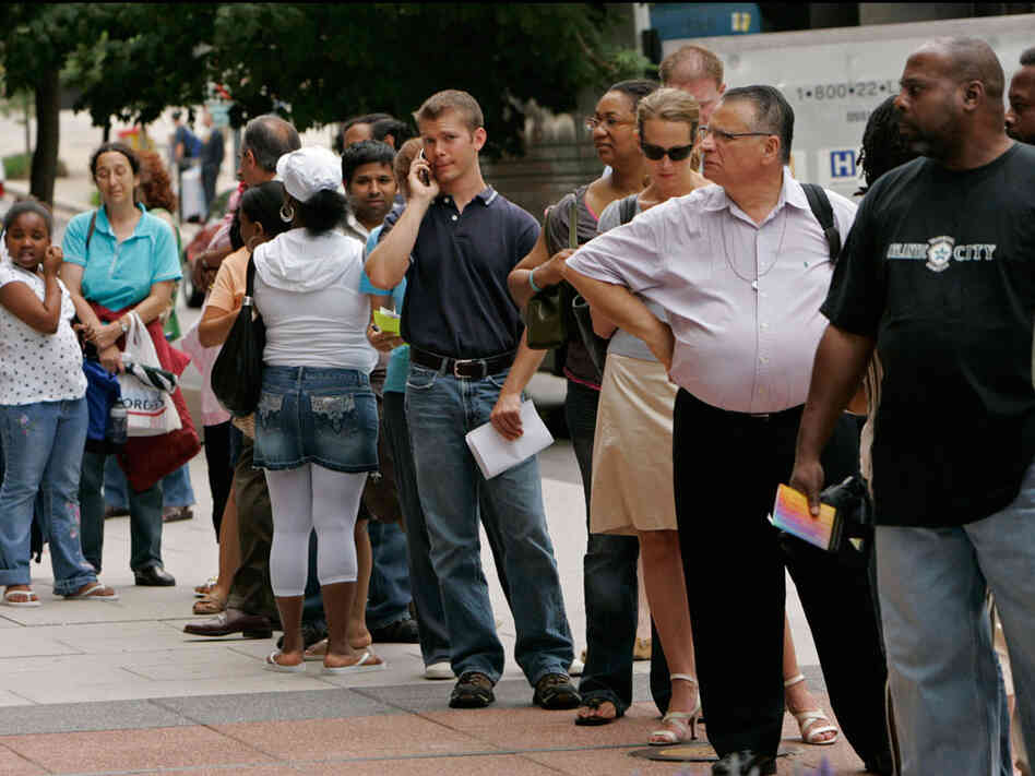 People wait in line outside the U.S. passport office in downtown Washington in 2007.