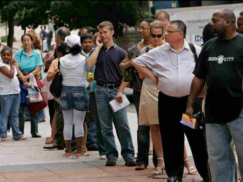People wait in line outside the U.S. passport office in downtown Washington in 2007.