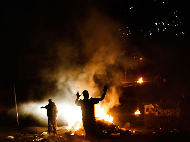 Fires burn on the streets of Petionville, outside of Port-au-Prince Haiti, Dec. 7, 2010