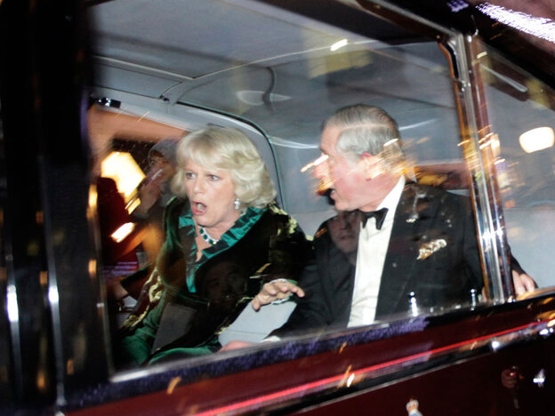 Charles and Camilla react during the attack.