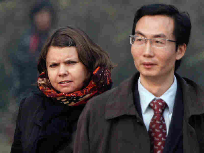 Canadian Karen Patterson (left), wife of Chinese artist Wu Yuren, walks with her lawyer Li Fangping