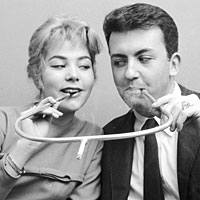 A cigarette holder built for two, circa 1955