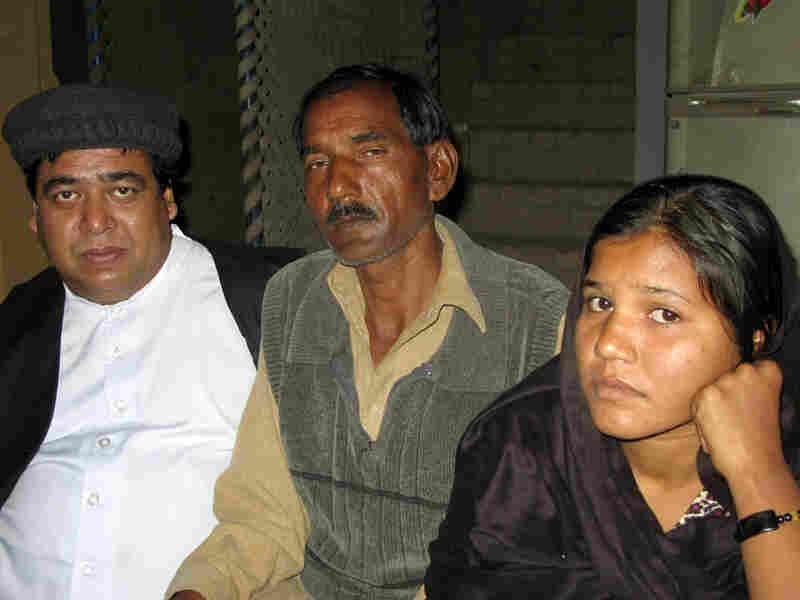 The Rev. Samson Dilawar, a Catholic priest, with Ashiq Masih, husband of Asia Bibi, and daughter Sidra