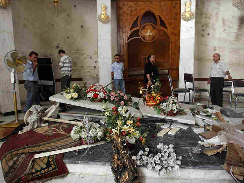 Iraqi Christians inspect damage at Our Lady of Salvation Church