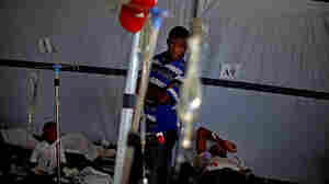 A man looks over a room of cholera victims in Port au Prince, Haiti, Dec. 10.