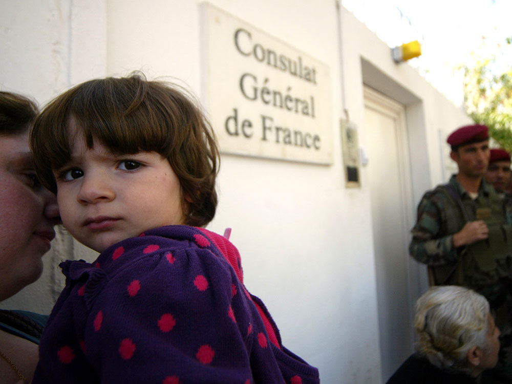 Iraqi Christians hoping to emigrate to France wait outside French Consulate in Irbil