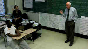 Retired cosmetics executive Mark Goldsmith gives inmates tips about how to handle job interviews.