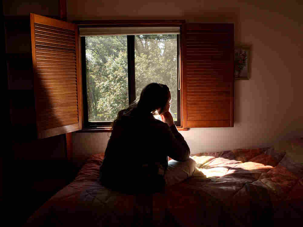 """A victim of domestic violence, who calls herself, """"Sierra""""  is seen at a safe house in Nevada County, Calif."""