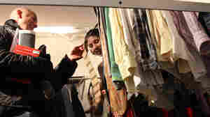 Lisa Tumbarello, a stylist trained by Stacy London from TLC's What Not to Wear, encourages Tom Spinelli to buy some ties from a Goodwill trunk show.