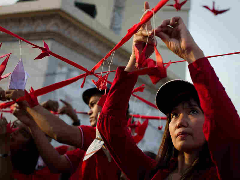 Red Shirt protesters hang red paper birds symbolizing freedom