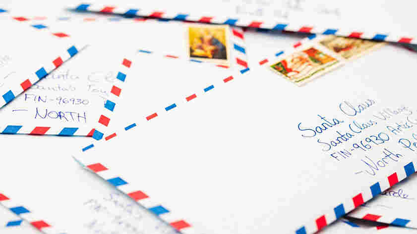 Envelopes addressed to Santa in the North Pole.