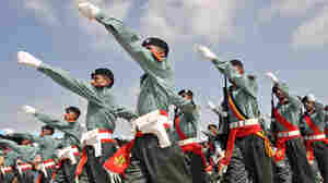 A contingent of Pakistani troops march during a parade at a military training center in Karachi.