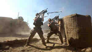 U.S. soldiers return fire upon a sudden attack by Taliban on Combat Outpost Badel in eastern Afghanistan